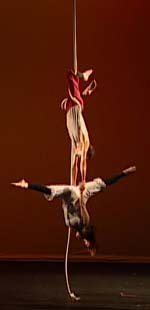 James Jay with Melissa Kerber on the vertical rope, performing with Circus Contraption.